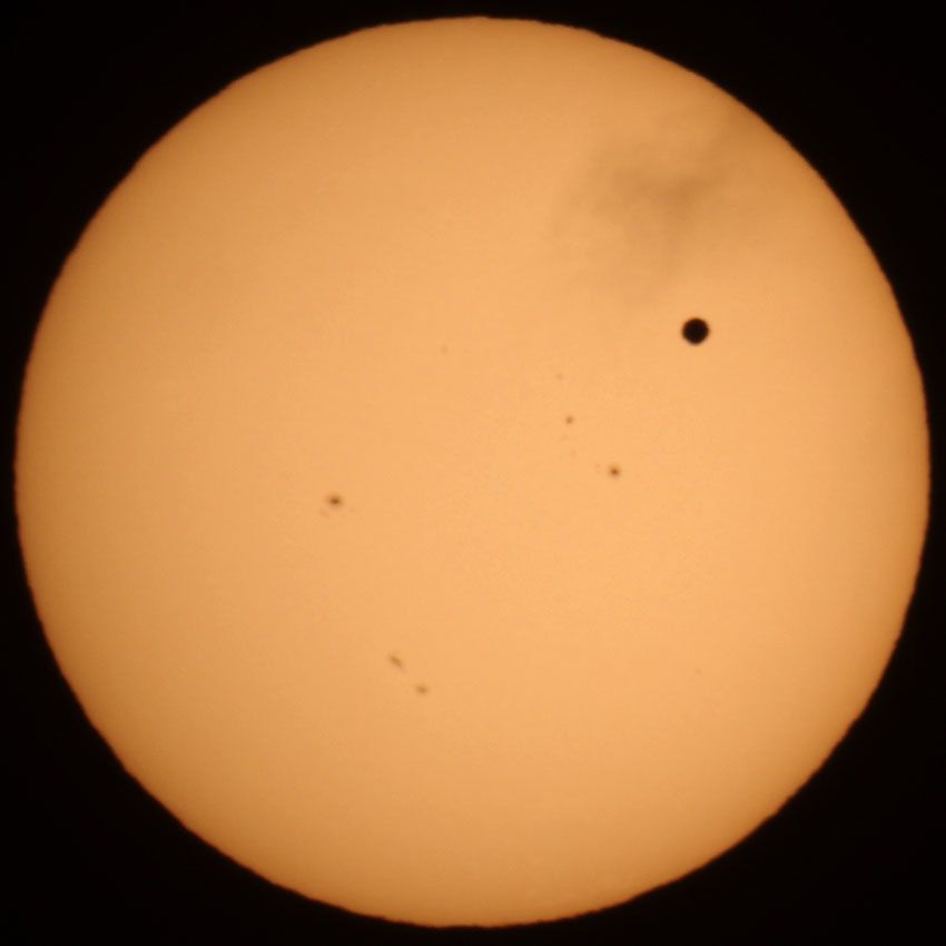 Transit of Venus with Cloud Whisp
